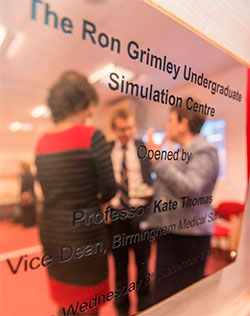 Mr Atiq Rehman and Professor Kate Thomas opening the plaque for the simulation centre